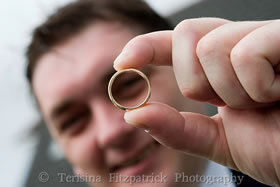Best man holds the wedding ring